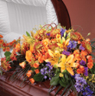 Casket Spray of various flowers from Sidney Flower Shop in Sidney, OH